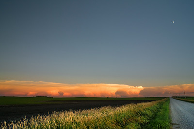 Storm approaching over the corn fields as the moon rises