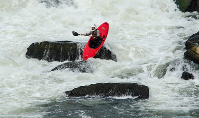 Kayaker having an exciting ride through the Great Falls, Potomac River