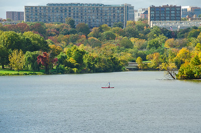 Two boaters pass in the Potomac River, Washington D.C.
