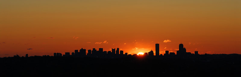 <b>Silhouette of Boston at Sunrise</b>   (Oct 21, 2006, 08:04am)  <p align=left>From Prospect Hill in Waltham, the sun rises behind Boston in mid-October and mid-February.  This year, the weather was not idea; this shot is the best from three trips to the overlook.</p>