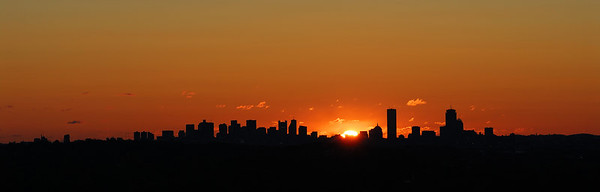 Silhouette of Boston at Sunrise   (Oct 21, 2006, 08:04am)  From Prospect Hill in Waltham, the sun rises behind Boston in mid-October and mid-February.  This year, the weather was not idea; this shot is the best from three trips to the overlook.