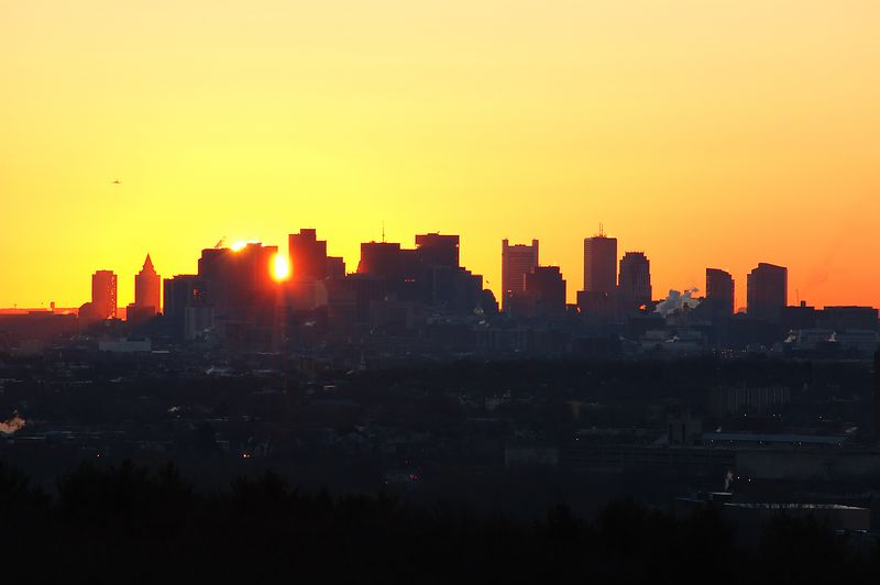 <b>Boston Sunrise - December 18th</b>   (Dec 18, 2004, 07:12am)  <p align=left>Four days later, and I am back at Robins Farm in Arlington.  There is no good cloud cover to catch the sunrise so I zoom in close to the city.  At this time of year, the sun rises behind the downtown section of Boston.</p>