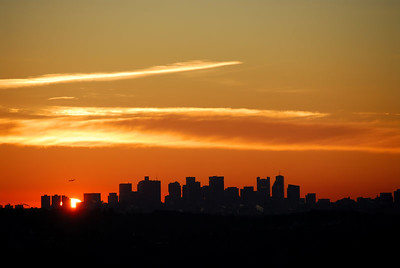Boston sunrise   (Mar 02, 2006, 06:17am)  This is the Boston skyline with the sun peeking out from the horizon.  This picture was taken from Prospect Hill park in Waltham, MA.