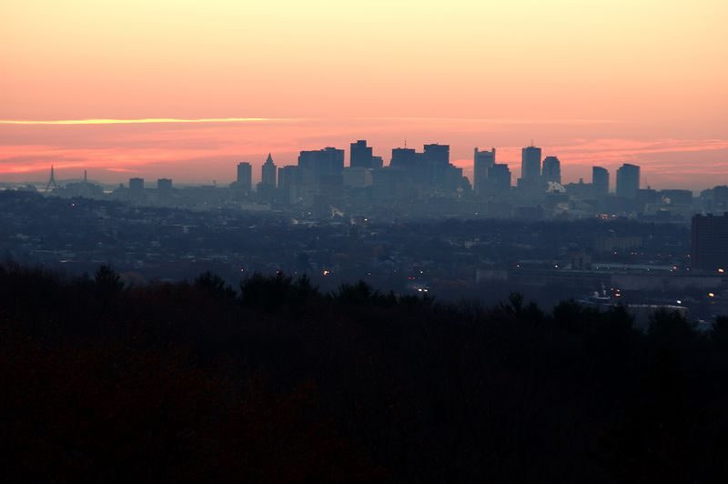 <b>Boston in pre-dawn light</b>   (Nov 27, 2004, 06:45am)  <p align=left>Robbins Farm in Arlington, MA, just down from the water tower.  Unlike Prospect Hill Park, it only takes me ten minutes from when I climb in to my car until I am setup to take pictures at Robbins Farm.  This makes Robbins Farm more convenient, except that it is further north than Prospect Hill Park.  From Arlington, the sun rises behind Boston only in December.</p>  <p align=left>On November 27th, with no clouds in the sky, I drove over to Robbins Hill Park and set up for the sunrise.  I took this picture a few minutes before the sun came up.</p>