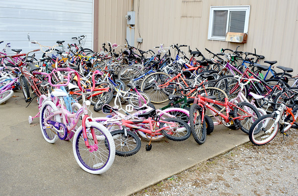 A collection of bicycles, donated to Joe's Car Care of Altamont, waiting to be repaired before they are given away. Charles Mills photo