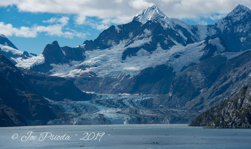 A Glacier's Flow Takes the Mountain Along