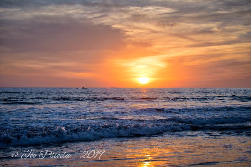 Sailboat Follows the Sunset