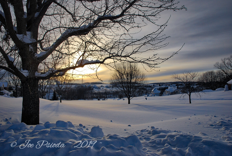 Snow Captures Glow of the Setting Sun