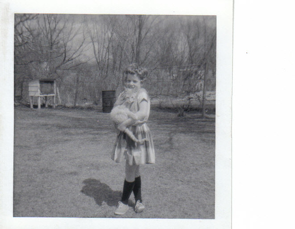 Early 1960's Photo taken in the backyard of the Toddville Iowa house. The cat was names SPICEY