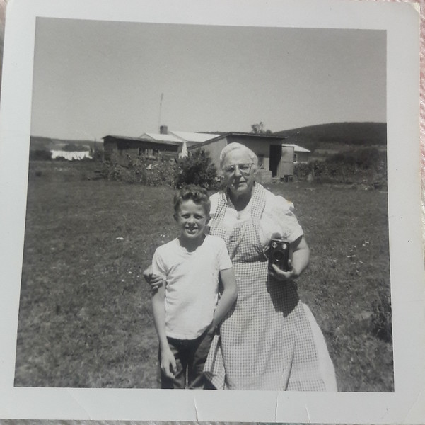 Approx. 1963  My grandmother and her brownie Box Camera. This Photo taken in the backyard of the Millville Pennsylvania House