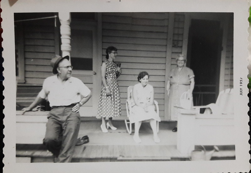 July 1957 Aunt Louise in polka dot dress and Joanne Robbins sitting in the chair