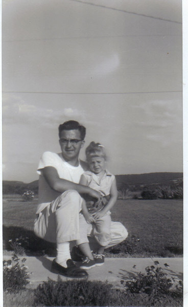 Approx. 1960 Photo of My father and LouAnn taken on the sidewalk of my Grandmother Millville Pennsylvania