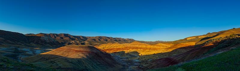 The Setting Sun Paints Long Shadows Across the Hills