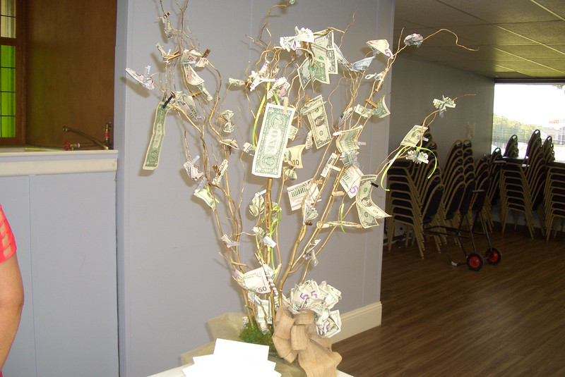 John's farewell gift from the church was a money tree.