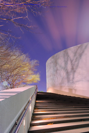 John F. Kennedy Library, Boston<br /> <br /> The streaks that appear to be coming from the tree's shadow are actually clouds at sunset, blown by high winds during a long (2.5-minute)-exposure!