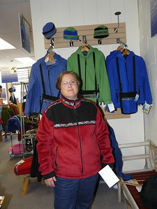 Colleen trying on coats at Copper River Fleece Co. in Cordova, Alaska.