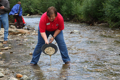 Colleen panning for gold in Dawson City, YT - Photo by Becky Gould.
