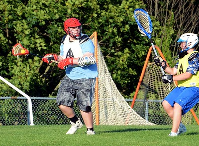 Erik Fisher, of Neshaminy, pressures Egan goalie.