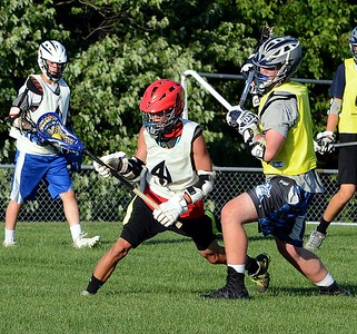 Corey Renman, left, eludes Egan defender in a recent duel for the Arrowhead Summer Lacrosse League.