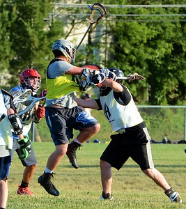 Neshaminy goalie Mike Vecchione, right, stops Egan attacker.
