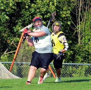 Neshaminy goalie Joe Ardin avoids pressure to clear ball upfield.