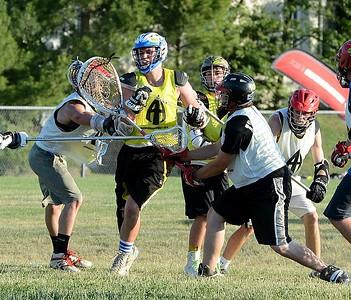 Neshaminy goalie Mike Vecchione thwarts Egan attack.
