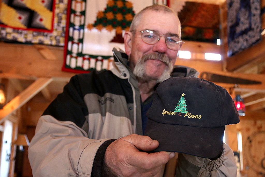 . John Hussey\'s Christmas tree farm in Townsend was featured in a new made-for-TV movie that will air on the Ion Television channel on December 3, 2017. They changed the name of Hussey\'s farm to Spruce Farm and that they gave him a hat made for the movie with movie title on it, Spruces & Pines. SUN/JOHN LOVE