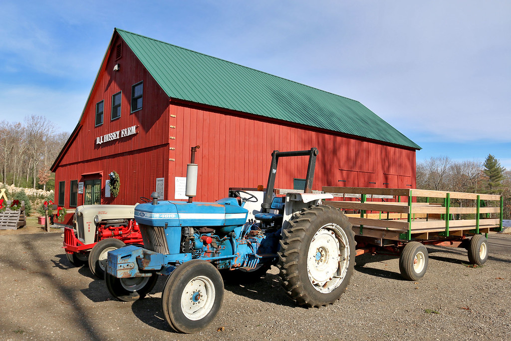 . John Hussey\'s Christmas tree farm in Townsend was featured in a new made-for-TV movie that will air on the Ion Television channel on December 3, 2017. They used these tractors and flat beds for some scenes in the movie. In the background is the barn that used to shoot a wedding scene.  SUN/JOHN LOVE