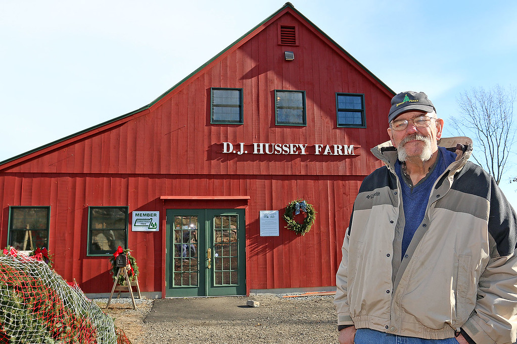 . John Hussey\'s Christmas tree farm in Townsend was featured in a new made-for-TV movie that will air on the Ion Television channel on December 3, 2017. Hussey outside the barn that was used for a wedding scene. SUN/JOHN LOVE
