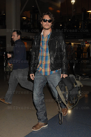 John Mayer arrived in Los Angeles airport from New York.