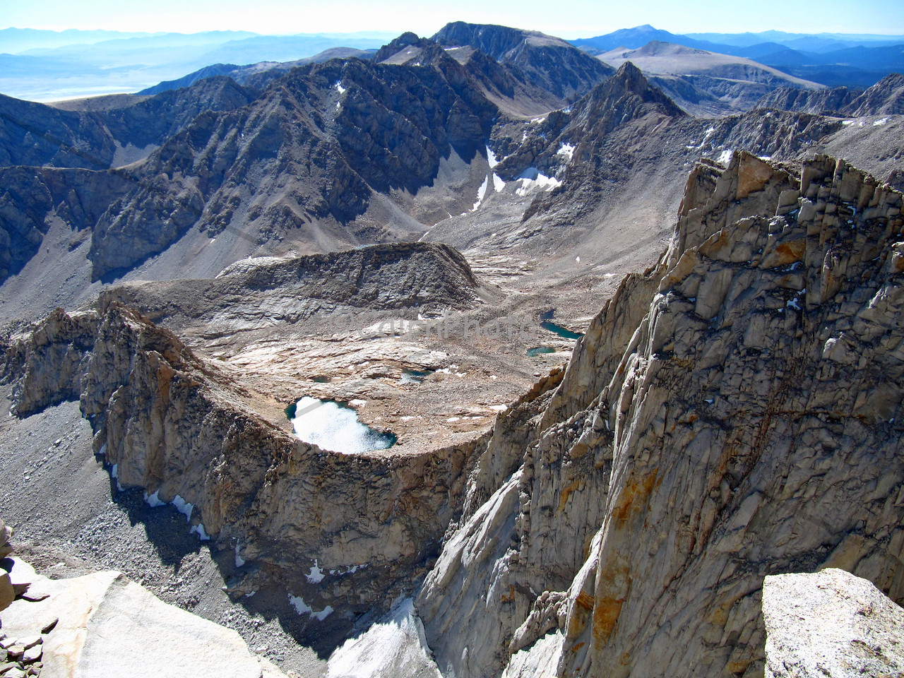 The view from Mt. Whitney, the highest mountain in the 48 contiguous states at 14,505 feet high.  Mt. Whitney is also the start and/or ending point of the John Muir Trail.
