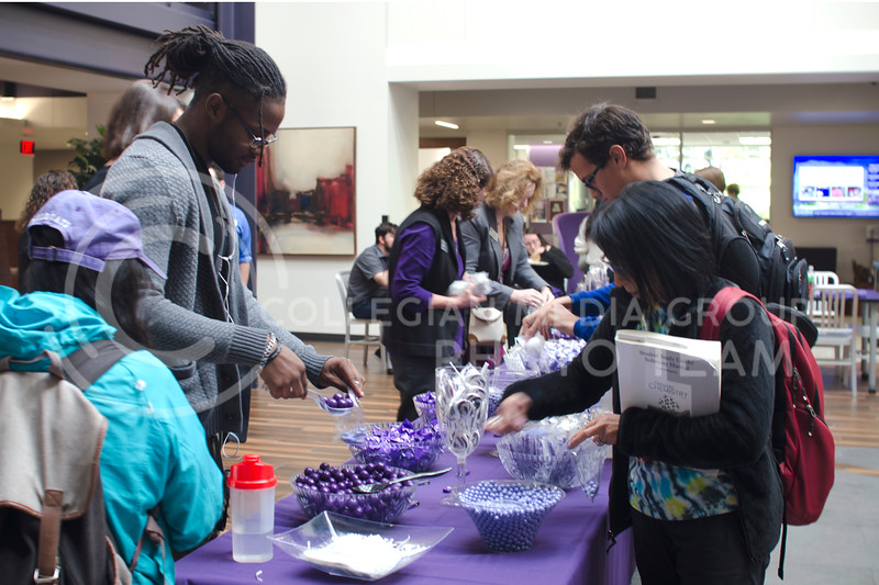 Students get free giveaways and candy bars during John Rush the Human iPod event over the lunch hour in the Union Courtyard at K-State Student Union on Oct. 11, 2017 (Saya Kakim | Collegian Media Group)