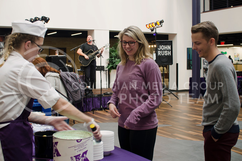 Alex Maynard and Ben Huddleston get free Call Hall ice cream during John Rush the Human iPod event over the lunch hour at K-State Student Union on Oct. 11, 2017 (Saya Kakim | Collegian Media Group) (Saya Kakim | Collegian Media Group)