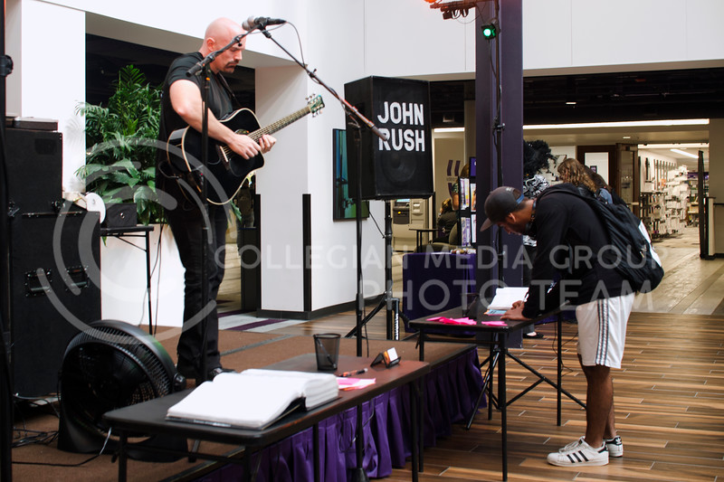 John Rush plays guitar and sings while taking requests from the audience over the lunch hour at K-State Student Union on Oct. 11, 2017 (Saya Kakim | Collegian Media Group)