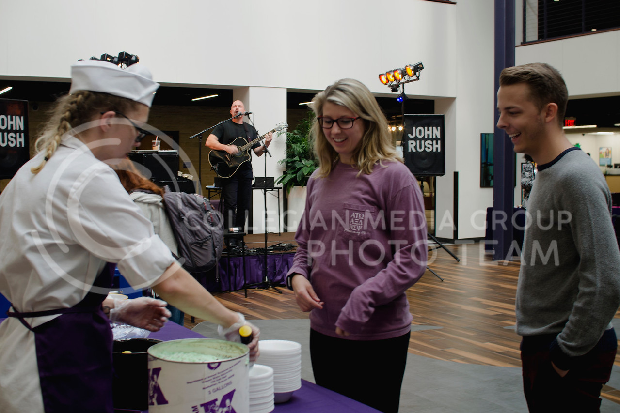 Alex Maynard and Ben Huddleston get free Call Hall ice cream during John Rush the Human iPod event over the lunch hour at K-State Student Union Courtyard on Oct. 11, 2017 (Saya Kakim | Collegian Media Group) (Saya Kakim | Collegian Media Group)