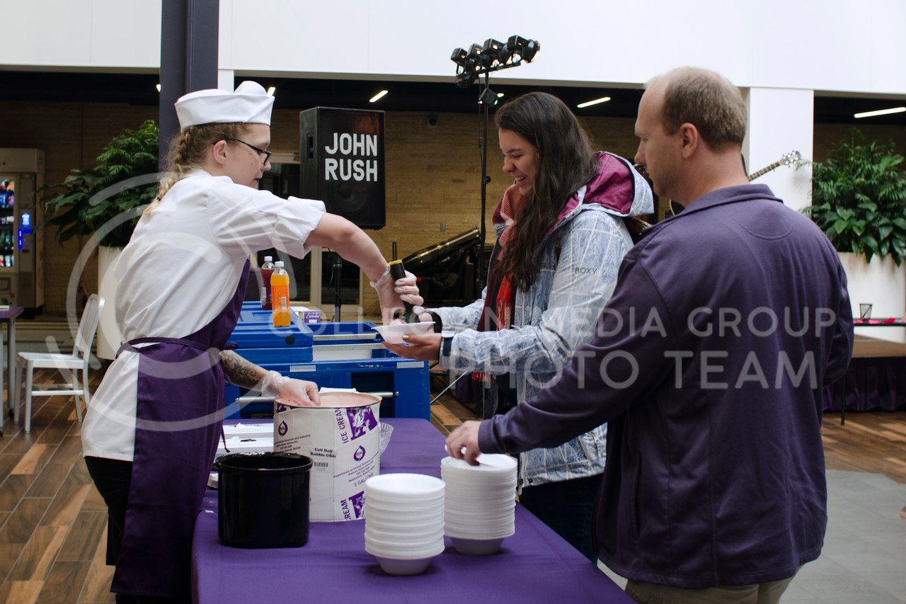 Students get free Call Hall ice cream during John Rush the Human iPod event over the lunch hour at K-State Student Union Courtyard on Oct. 11, 2017 (Saya Kakim | Collegian Media Group)