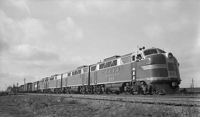 2021.003.ATSF.0103--john s ingles 116 neg--AT&SF--EMD diesel locomotive 103 on Friendship train 3 coaches 85 freight cars 1 caboose--Chillicothe IL--1947 1122