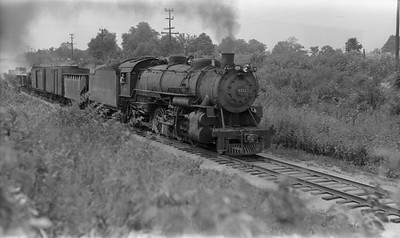 2021.003.BO.4511--john s ingles PC neg--B&O--steam locomotive 2-8-2 4511 on freight train action--between East St Louis and Shattuc IL--c1941 0000