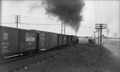 2021.003.GTW.0003--john s ingles PC neg--GTW--steam locomotive on eastbound freight train action at Valparaiso Tower--Valparaiso IN--no date