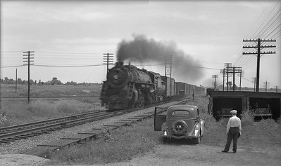 2021.003.GTW.0006--john s ingles PC neg--GTW--steam locomotive on freight train at Valparaiso Tower action--Valparaiso IN--no date