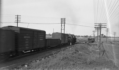 2021.003.GTW.0004--john s ingles PC neg--GTW--steam locomotive on eastbound freight train at Valparaiso Tower--Valparaiso IN--no date