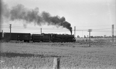 2021.003.GTW.0005--john s ingles PC neg--GTW--steam locomotive on eastbound freight train at Valparaiso Tower--Valparaiso IN--no date