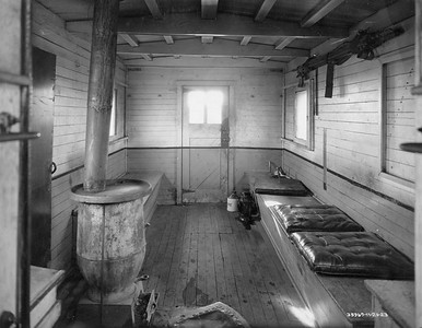 2021.003.PDTI.025--john s ingles 8x10 print--DT&I--company photo of wooden caboose 41 interior--location unknown--1922 1121