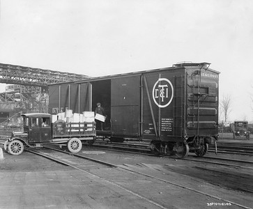 2021.003.PDTI.020--john s ingles 8x10 print--DT&I--company photo of wooden boxcar 17337 being loaded from a truck--location unknown--1923 1121