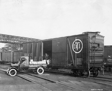 2021.003.PDTI.022--john s ingles 8x10 print--DT&I--company photo of wooden boxcar 17337 being loaded from a truck--location unknown--1923 1121