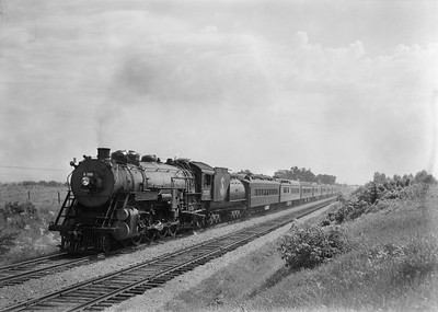2021.003.GN.2525--john s ingles 6x9 neg--GN--steam locomotive 4-8-4 2525 on 8-car passenger train action--location unknown--no date