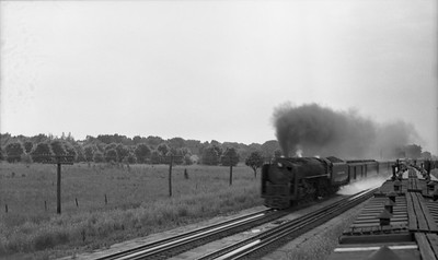 2021.003.NYC.0001--john s ingles PC neg--NYC--steam locomotive on eastbound passenger train action taking water from pans--Chesterton IN--no date