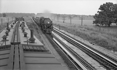 2021.003.NYC.0005--john s ingles PC neg--NYC--steam locomotive on westbound passenger train action taking water from pans--Chesterton IN--no date