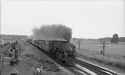 2021.003.NYC.0002--john s ingles PC neg--NYC--steam locomotive on westbound passenger train action about to take water from pans--Chesterton IN--no date
