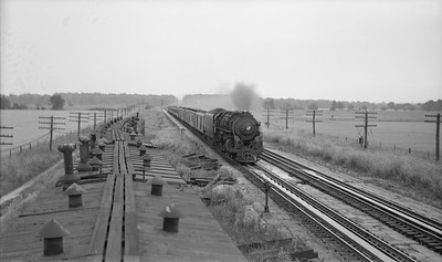 2021.003.NYC.0006--john s ingles PC neg--NYC--steam locomotive on westbound passenger train action taking water from pans--Chesterton IN--no date
